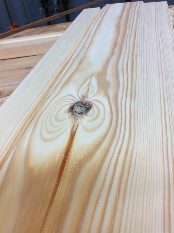 planed pine plank with ace-of-spades-shaped knot